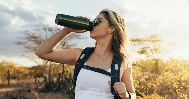 Woman hiking with water bottle